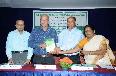 Release of Prof.K.N.Ninan s book by Dr Ulhas K.Karanth