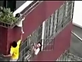 boy hangs in balcony above 40ft video videos