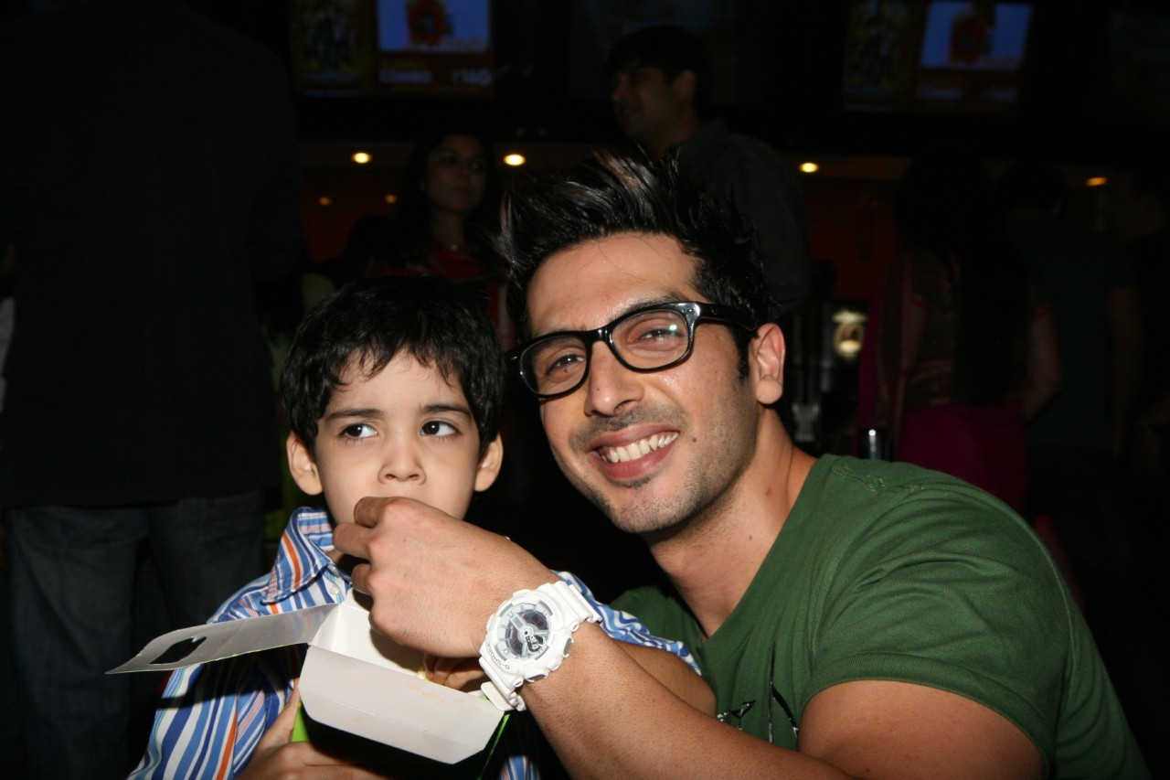 zayed khan feeding popcorn to his son zidaan at film love