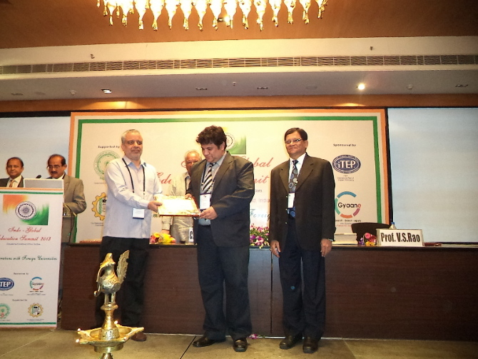 Mr.Ashok Kallam CEO IGS  Receiving Excellence award from Prof.V.S.Rao  Director BITS Pillani Hyderabad and from A.P Higher Education Secretary