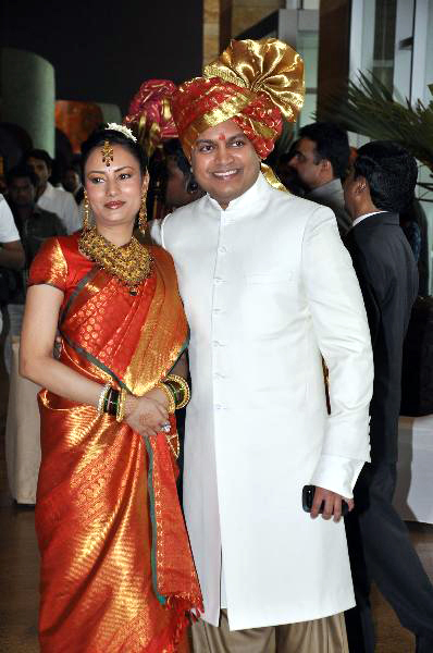 Amit Deshmukh posing with wife Aditi at his brother Ritesh Deshmukh Genelia Wedding ceremony in Mumbai Photo