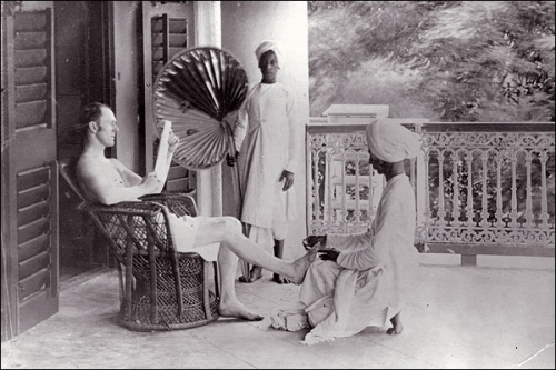 A British saheb with his Indian servants